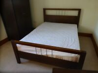 Bed Frame, Wardrobe, Chest of Drawers and Mirror Set.