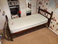Dark pine single bed on wheels with good quality mattress