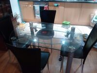 Glass dinning table with 4 leather chairs