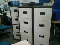 Filing cabinet with white drawers and key