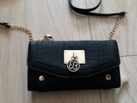 Ladies black purse with detachable strap. Brand new. No tag but boxed