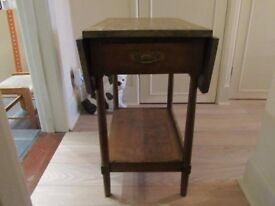 Antique oak occasional table with extendable flaps and two drawers