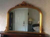 Gold mirror for sale.