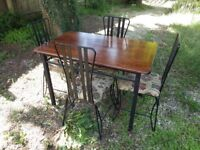 A NICE METAL FRAMED DINING TABLE and FOUR CHAIRS