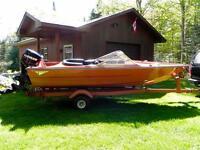 Cutter boat and trailer with Evinrude motor