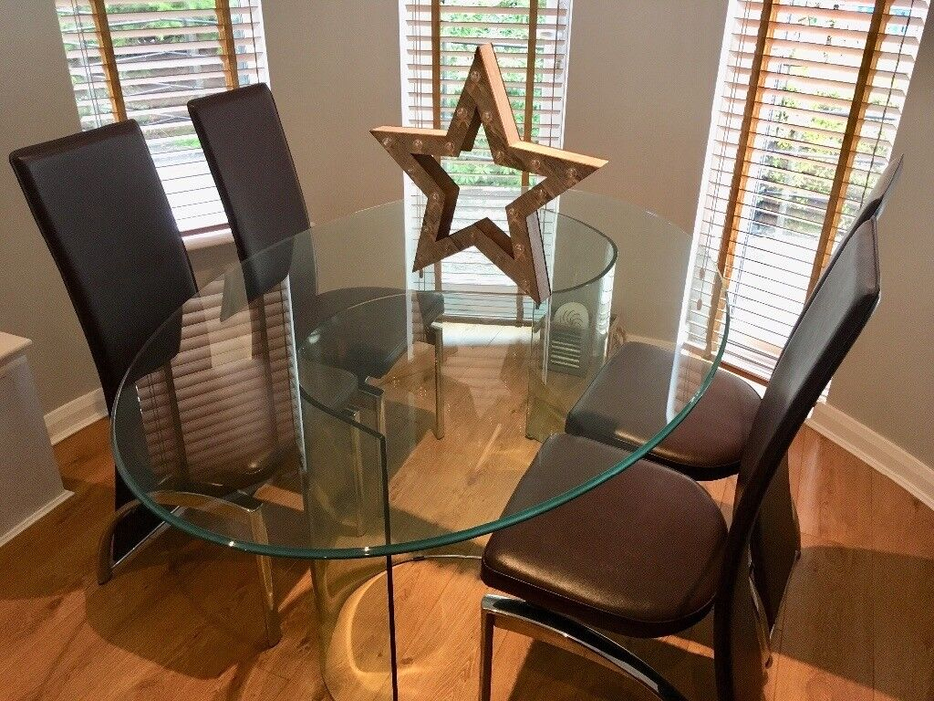 Glass dining room table and 4 brown and chrome metal chairs