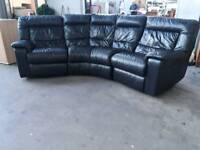 Electric Black leather recliner sofa in pristine condition. Also in perfect working order