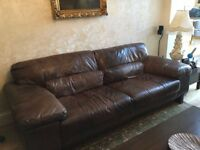 Brown leather 3 seater sofa, footstool, chair.