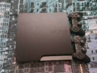 PS3 Slim console with games