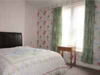 Large happy house close to town train and bus stations and 10 min walk to town and beach