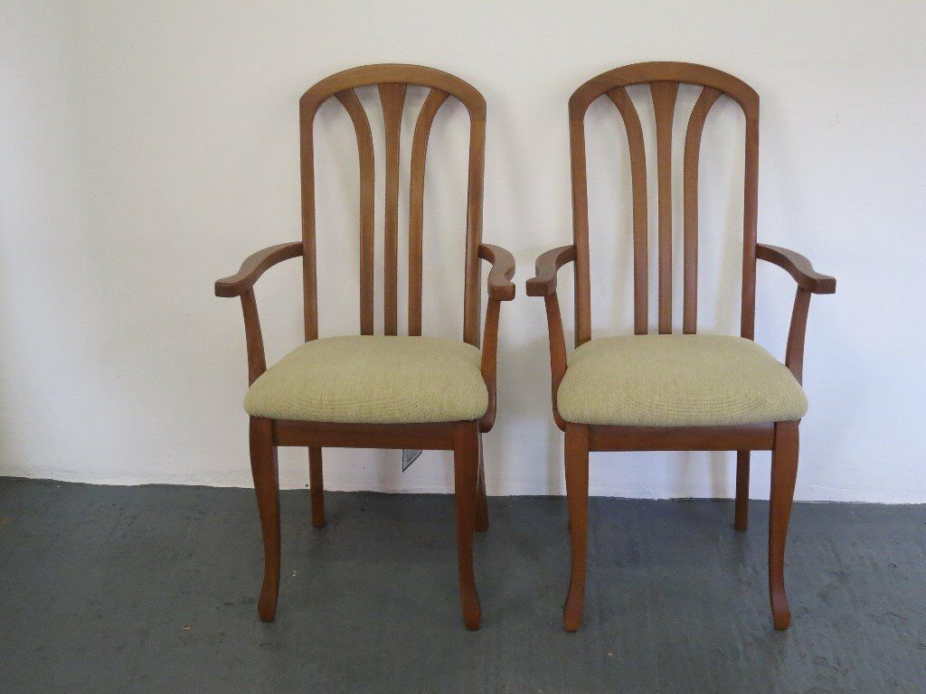 Pair of modern teak carver chairs from nathan furniture
