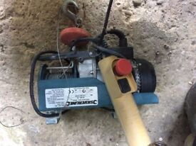 Electric hoist building and other material lifter
