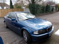 Bmw 320i coupe in metalic blue with only 64500 miles