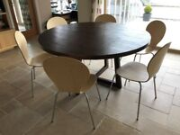 150cm round dining table with six chairs. Good condition although some marking on veneer of top