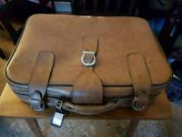 Vintage 1970s leather suitcase