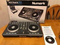 Numark pro cd mixer on box with disks and booklets