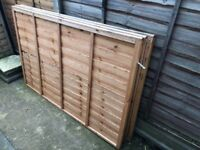 3 x garden fence panels. Immaculate condition. Natural brown one side, painted black the other.