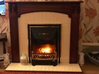Electric Fire and Surround in very good condition, with coal effect