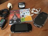 PSP 1004 with case and games