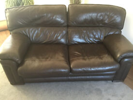 Brown leather 2 seater sofa and single large armchair.