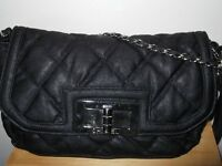 Black Quilted Chanel??? Leather Handbag.