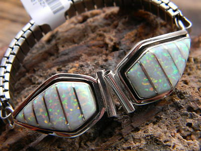 Spectacular sterling silver Navajo made ladies watch band 12 white fire opals