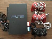 PS2 with 3 remotes and 5 games