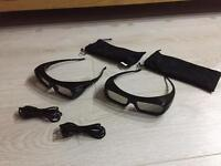 Two Sony 3D glasses with USB charging cables
