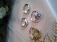 £25 for all 4 solid silver rings with stones in them and one large stone stamped 925 ono