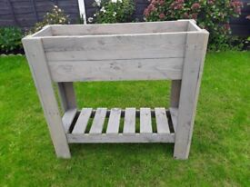 High standing planter box very well made light grey in colour with shelf