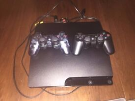 Playstation 3 + 2 controllers + choice of 5 games