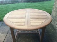 Lovely teak table 4ft 2 inches closed (round) 6ft 2 inches extended