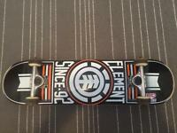 Element Skateboard with a tool