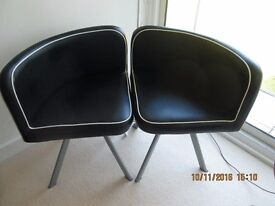 Two piece black and white designer quadrant lounge chairs