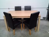 Ex display set 4 dining chairs, black faux and FREE table. Bargain, can deliver.