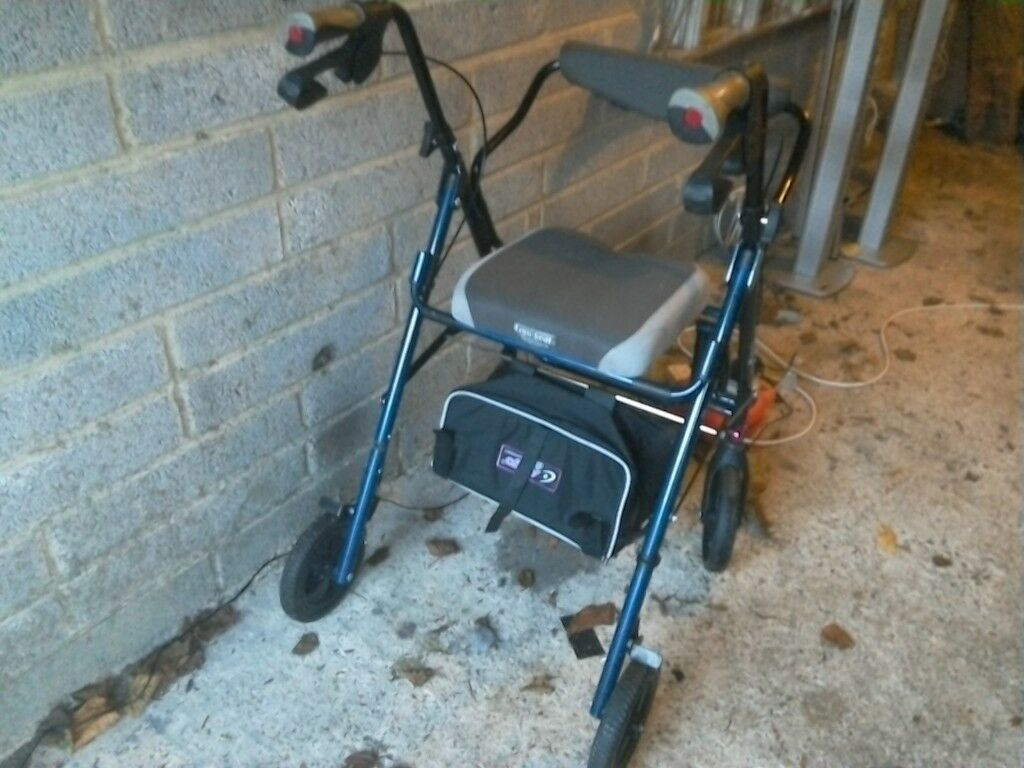 Rollator and chair with padded seat and back with bag twin brakes folds up vgc can deliver local