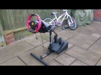 Xbox one steering wheel and stand. Fully adjustable and hardly used.