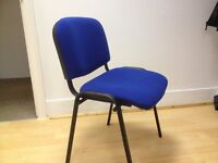 Blue office stacking chairs with padded seats - collect from London W1