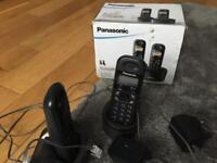 Panasonic double phone with plug in chargers. Boxed with instructions