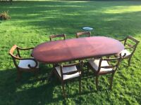 Bradley mahogany table and six upholstered chairs
