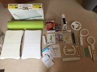 Nintendo Wii with accessories, games & 2 fit boards