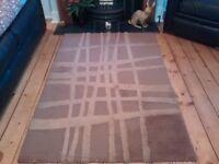 Medium sized brown wool rug 168cm x 110cm