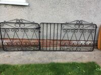 Black double gates, 90.5 cms high, 1 gate 99cms wide and the other gate 158cms wide including posts