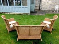 Wicker furniture set with cream cushions