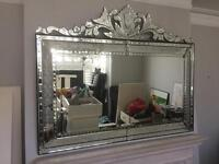 VERY LARGE ORNATE MIRROR IN MINT CONDITION.