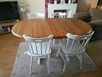 A pine shabby chic extending dining table and 4 chairs