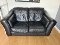 Black leather 2 and 3 seater sofas
