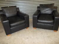 Two matching Designer Black Leather Armchairs (Sofa/Suite)