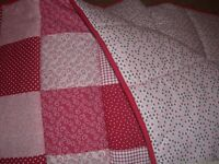 Brand new homemade red patchwork cot quilt