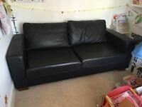 Marks and Spencer's black leather double sofa bed.